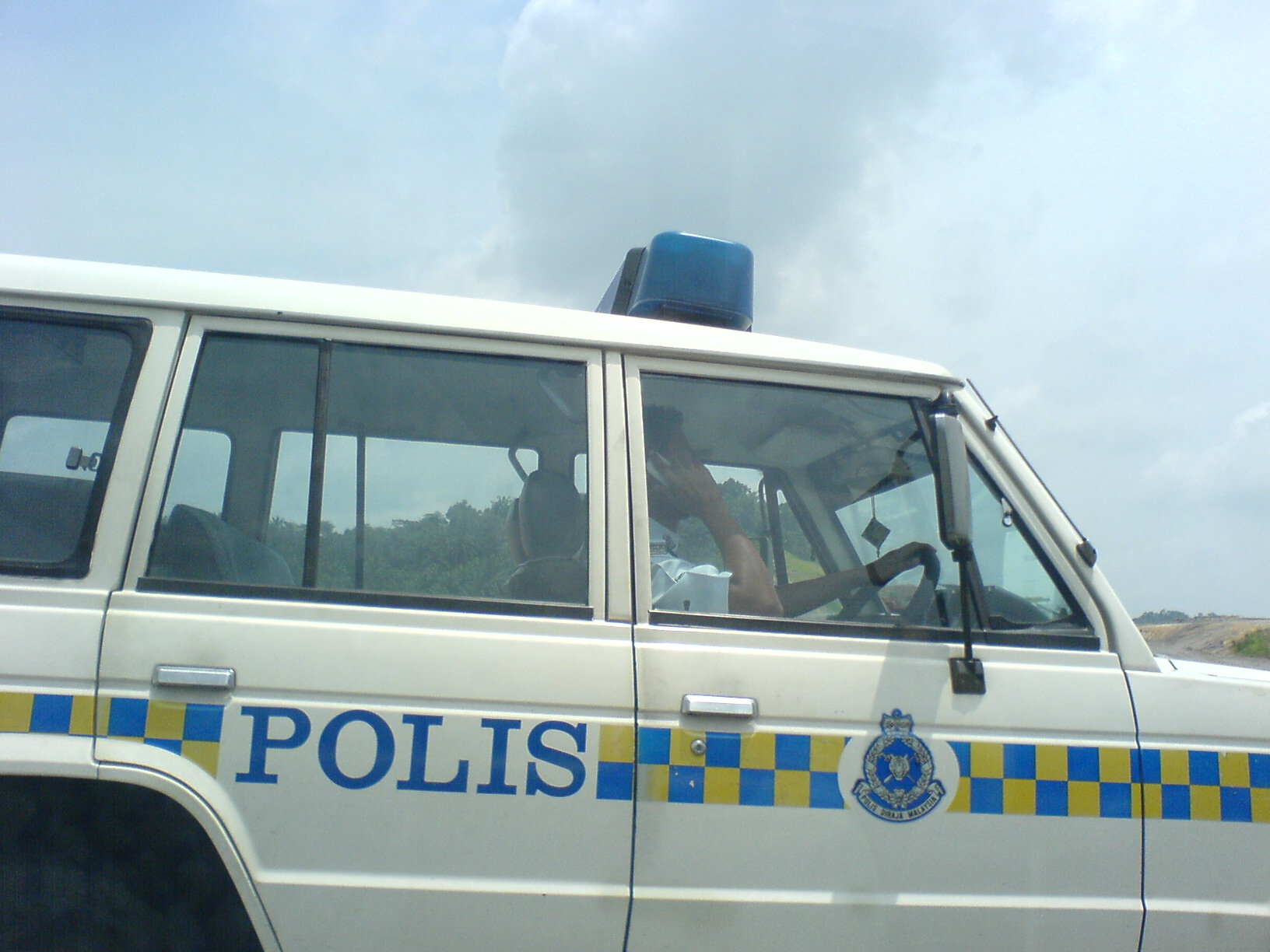 Police on the phone while driving